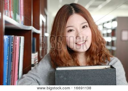 young asian girl in library