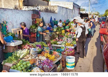 CHETUMAL, MEXICO-DEC 16., 2015: People at the  green vegetable market on Dec 16, 2015 in Chetumal, Mexico.