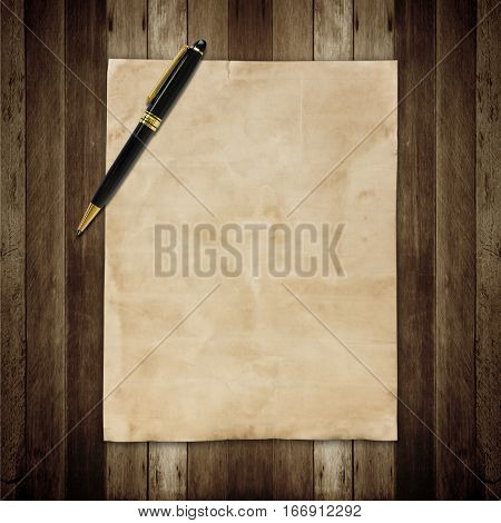 Notepaper and pen on a wooden background.
