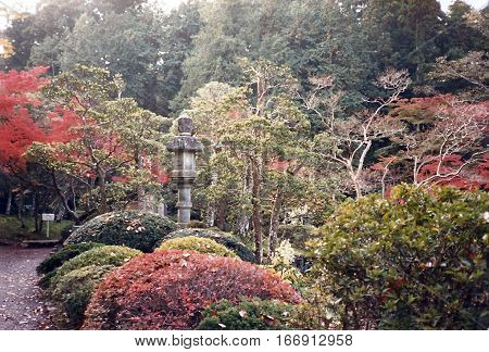 A stone lantern in a garden at the Narita-san Shinshō-ji Shingon Buddhist temple in Narita, Japan, during November, 1987.