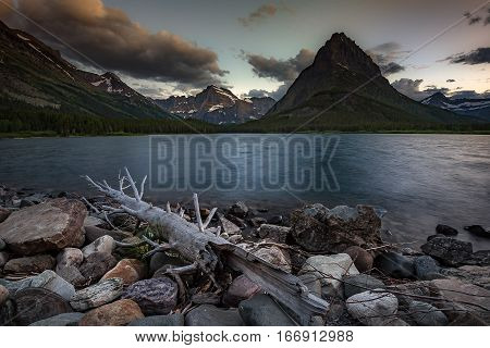 Colorful sunset over Swiftcurrent Lake in Glacier National Park Montana. Landscape Photography