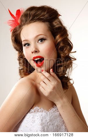 Gorgeous pin-up bride close-up.Professional make-up hair and style