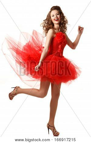 Pin up girl in red with flying dress.Professional make-up hair and style