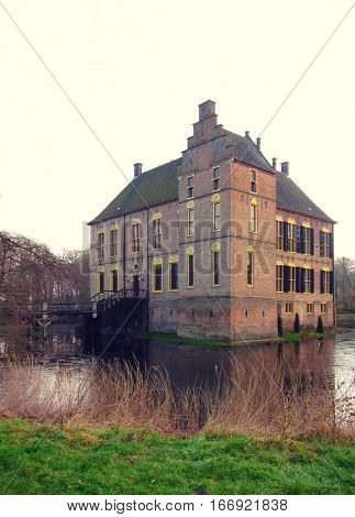 Ancient medieval stone fortress surrounded by water channel, castle Vorden, Netherlands, Europe