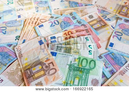 Close up top view euro banknotes pile