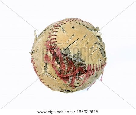 An old baseball that has seen better days. Torn stitches Discolored leather ripped and torn sitting on a clean white background.