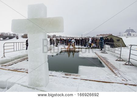 KAZAN, RUSSIA - JANUARY 19, 2017: Jesus Christ's baptism holiday on kazanka river. Traditional winter bathing in center of city, telephoto