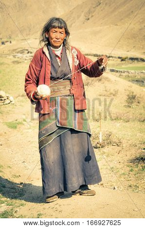 Grey-haired Woman With Wool In Nepal