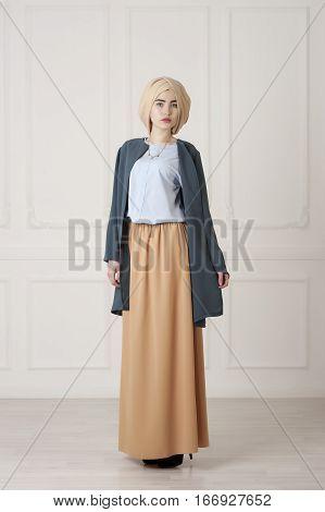 Studio photo of a beautiful Muslim woman in oriental dress and turban Tatarstan