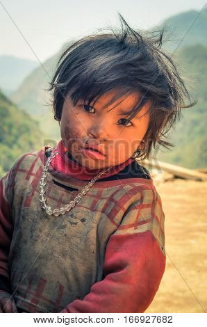 Sad Girl With Beads In Nepal