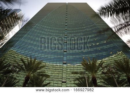 Stock image of an abstract building with palm trees