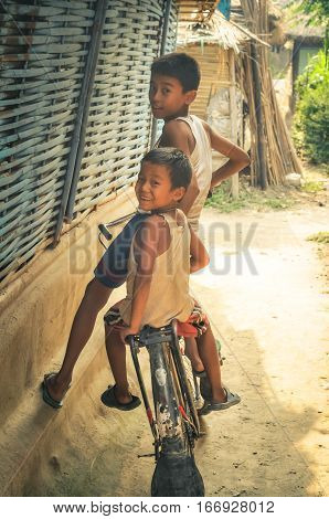 Boys On Bicycle In Nepal