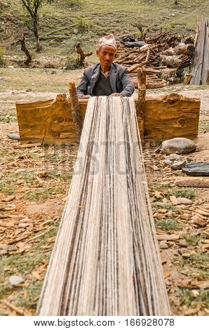 Weaving Man In Nepal