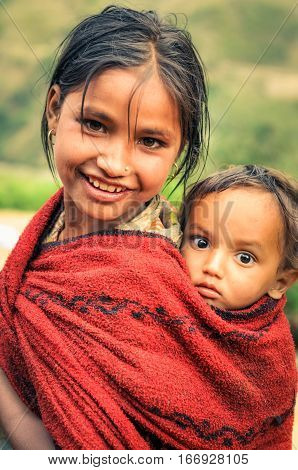 Small Boy With Big Brown Eyes In Nepal