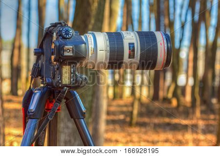 Gomel Belarus - March 29 2016: Digital SLR camera Canon EOS 6D with a long focus lens Canon EF 70-200mm f/2.8L IS II USM attached to the tripod