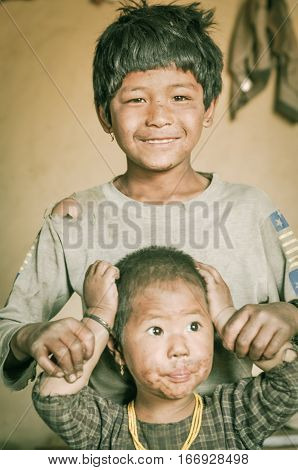 Young Siblings In Nepal