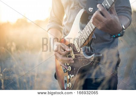 musician with guitar at sunset field music background Vintage Style