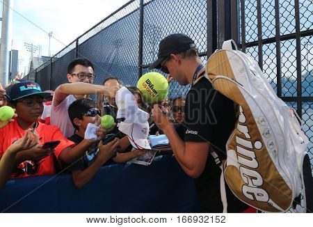 NEW YORK - AUGUST 27, 2016: Grand Slam Champion Bob Bryan signs autographs after practice for US Open 2016 at Billie Jean King National Tennis Center in New York
