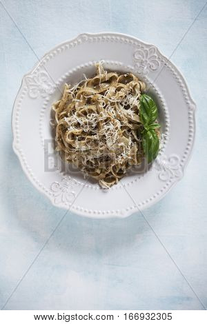 Italian pappardelle pasta wit pesto genovese, basil and parmesan cheese