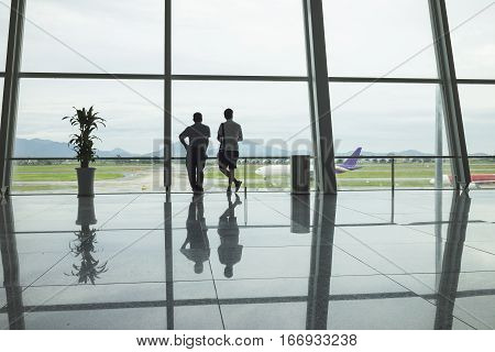 Airline Passengers Silhouettes At Airport