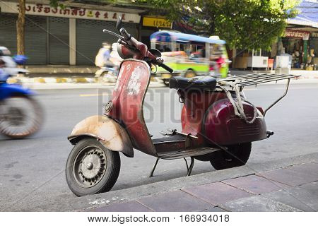 A Old Scooter Used For Carrying Goods On Asian Street