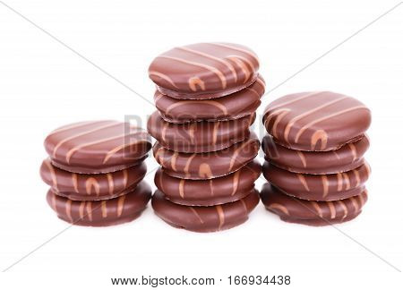 Heap of chocolate cookies isolated on white background.
