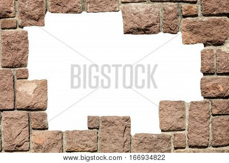 Stone bricks wall frame with empty hole. A wall of stone bricks with white space in the middle. Frame brick wall rocks.