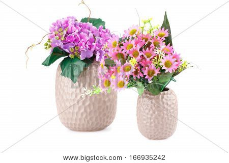 Colorful fabric flowers in vases isolated on white background.