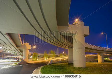 Under the bridge at night. Long exposure. Blue sky.