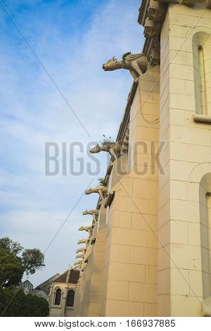 Side view of Asian Christian church against blue sky
