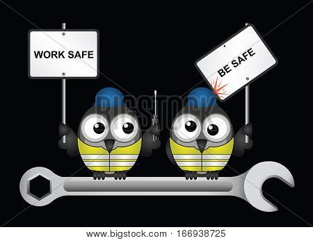 Comical construction workers with health and safety work safe be safe message perched on  a spanner isolated on black background