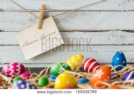 Colorful, Decorated Eggs And Raffia