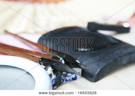 Chinese writing brushes and inkstone on the table