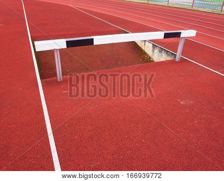 High hurdle. Hurdle track running lane. Wooden Hurdle On red High School Track poster
