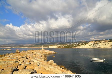 AKAMA HEIGHTS, CYPRUS - NOVEMBER 20, 2015: The fishing port of Agios Georgios with stormy sky