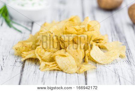 Potato Chips (sour Cream Taste) On Vintage Wooden Background