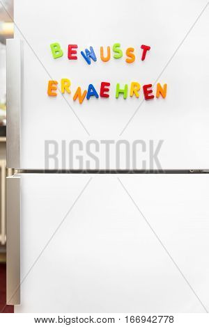 Colorful Magnet Letters With German Text, Healthy Nutrition, Copyspace
