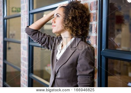 Frustrated businesswoman with hand on forehead in office