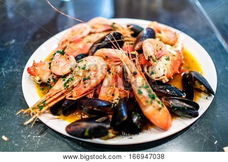 Shrimp, Crayfish And Mussels Are On The Big Dish In The Sauce.