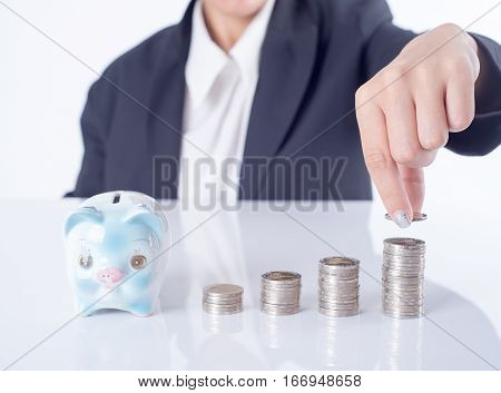 business women hand putting coin and piggy bank. concept saving finance and investment.