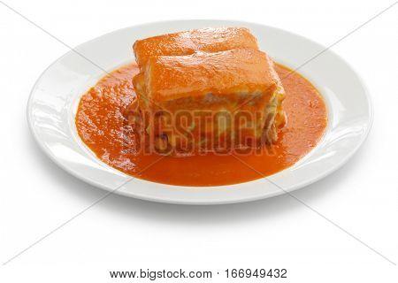 homemade francesinha, portuguese sandwich isolated on white background