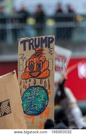Donald Trump demonstration placard. Stockholm, Sweden - January 21, 2017: Close up of placard sign during Anti-Trump day demonstration in Stockholm Sweden.  Donald Trump demonstration sign.
