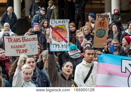 Transgender and equality protests. Stockholm, Sweden - January 21, 2017: Anti-Trump day demonstration in Stockholm. Young people gathered on public square to protest against Donald Trump.