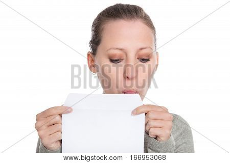 Young Woman Holding And Licking A White Envelope