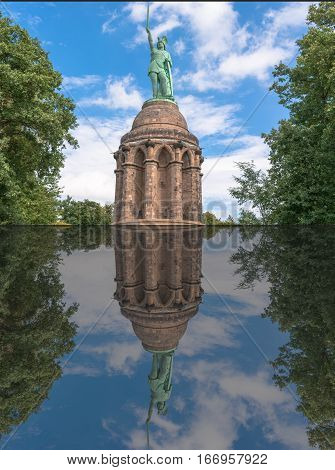 Reflection of the statue of the Cherusque prince Arminius in the Teutoburg Forest near the town of Detmold Germany.