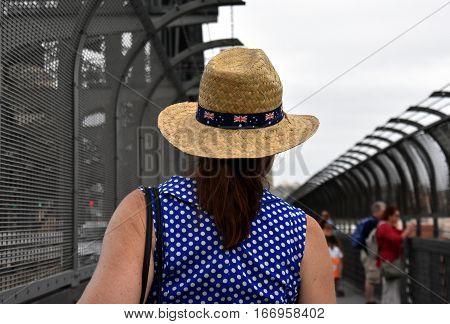 Sydney, Australia - January 26, 2016. A lady celebrating Australia Day in Sydney. Australia flag decorates the hat.