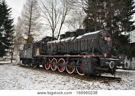 Beatiful black, retro and  steam locomotve . Winter is present.