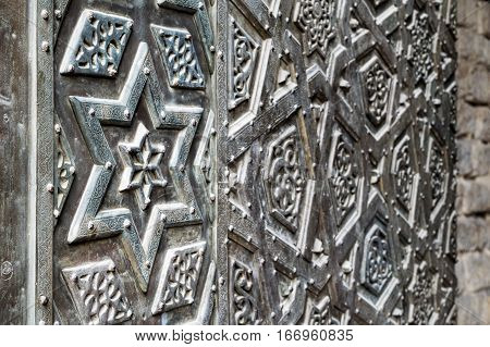 Ornaments of the bronze-plate door of Sultan Qalawun mosque containing the Star of David Old Cairo Egypt