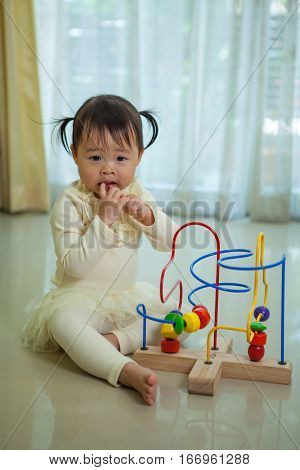 Portrait of little asian girl in home