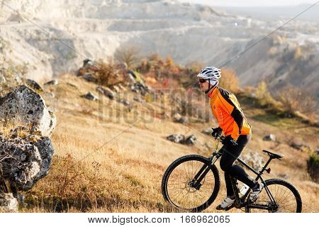 Mountain Bike cyclist riding Meadow track on sunny day. healthy lifestyle active athlete. traveling concept.
